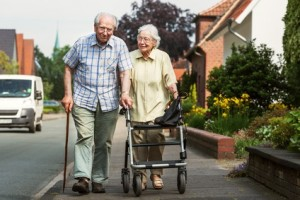 Elderly couple with walking frame